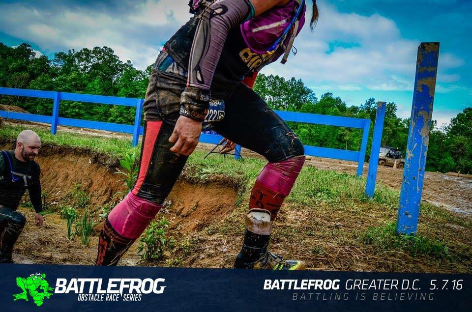 Melissa Dugan emerges from an BFX obstacle with her WTM headband visible around her wrist.